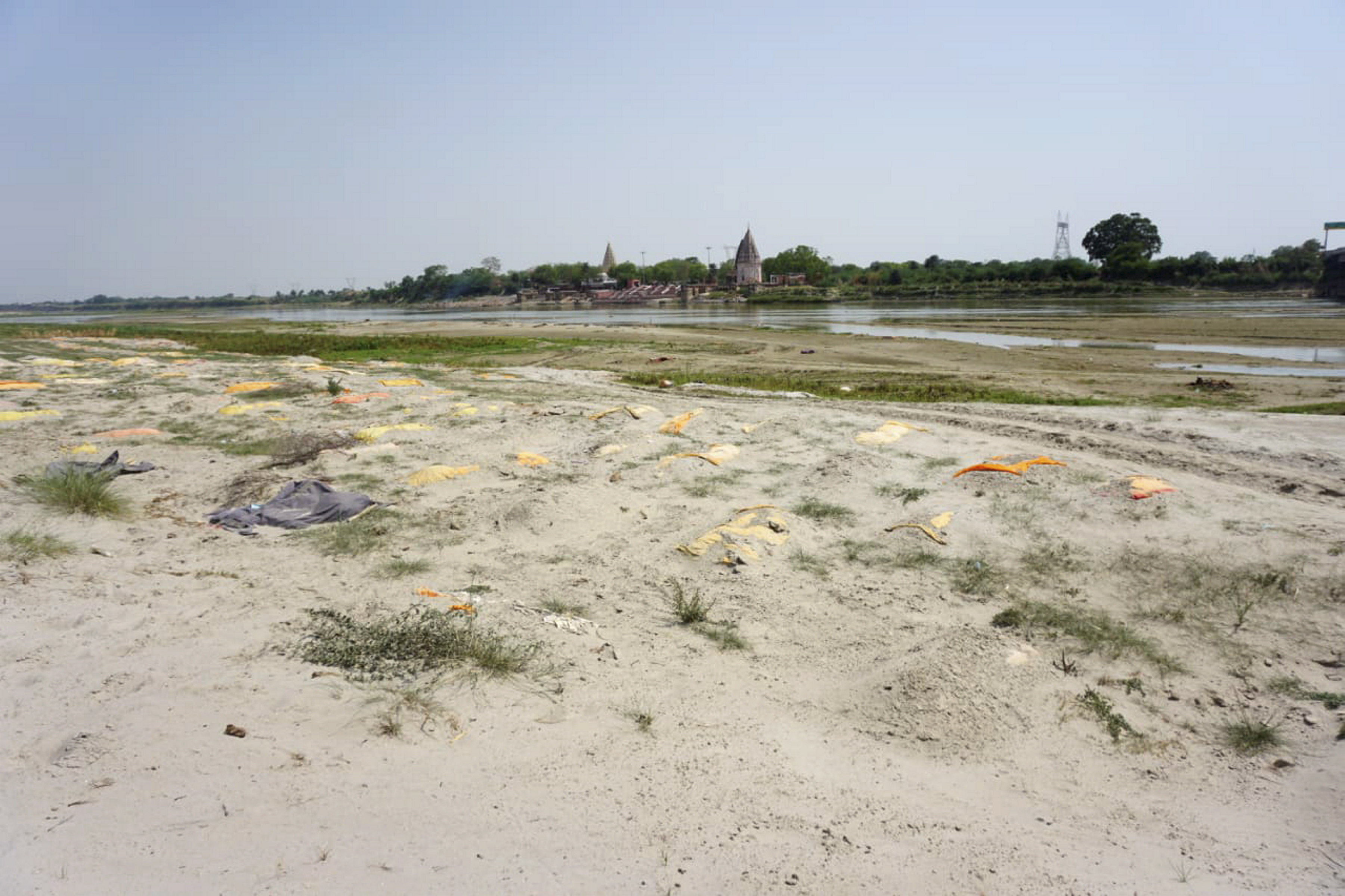 Kanpur: More than 300 bodies found buried near Ganga in Shivrajpur, Kanpur, Friday, May 14, 2021. (PTI Photo)(PTI05_14_2021_000193B)
