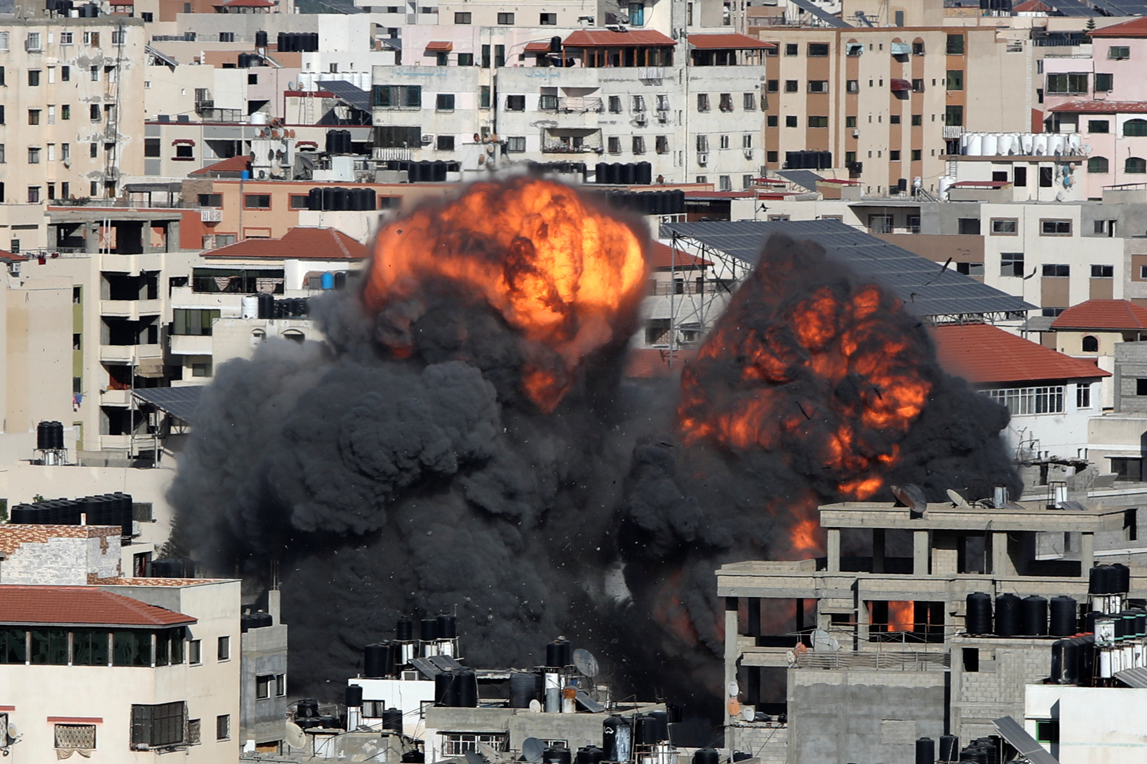 Smoke and flames rise during an Israeli air strike, amid a flare-up of Israeli-Palestinian violence, in Gaza City May 14, 2021. REUTERS/Mohammed Salem