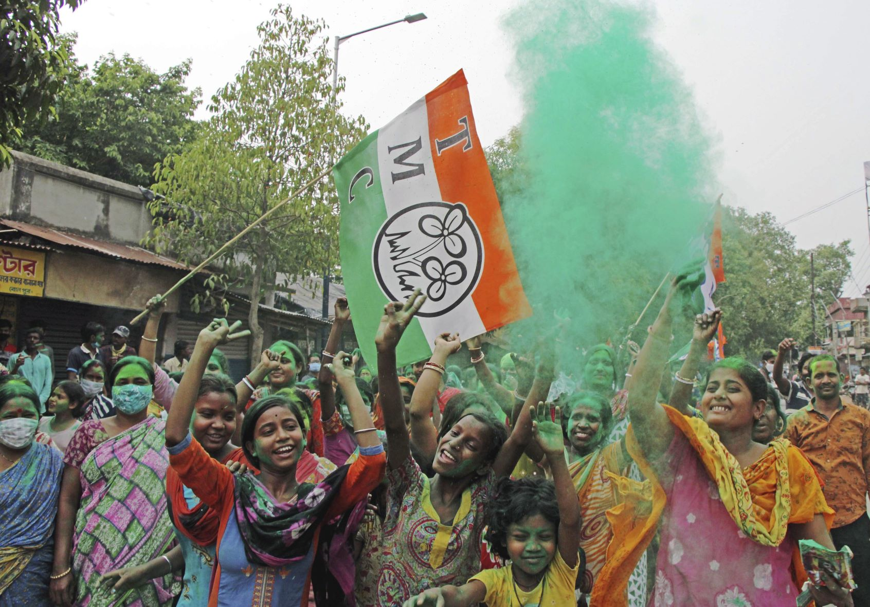 Birbhum: TMC supporters celebrate winning trend in the West Bengal state assembly elections at Bolpur in the Birbhum district of West Bengal, Sunday, May 2, 2021. (PTI Photo)(PTI05 02 2021 000235B)