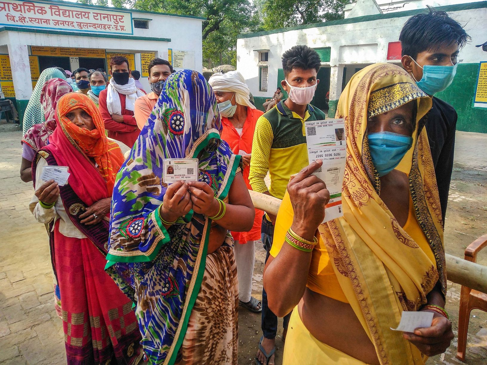 Bulandhsahar: Women wait in a queue to cast their vote for UP Pachayat Election at a polling station in a Ranapur village of Bulandshahar, Thursday, April 29,2021. (PTI Photo)(PTI04 29 2021 000114B)