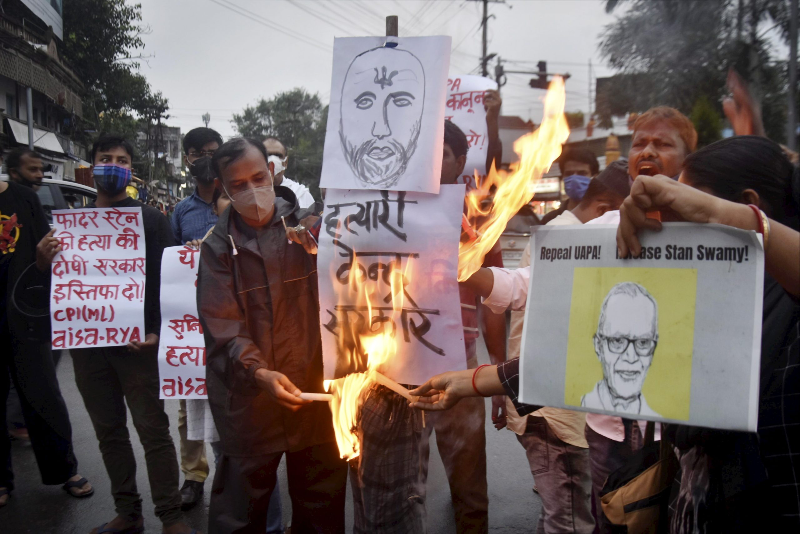 Ranchi: Activists participate in candle light vigil to pay tribute to civil rights activist Father Stan Swami, an accused in the Elgar Parishad-Maoist links case who died at a Mumbai hospital, in Ranchi, Monday, July 5, 2021. (PTI Photo)(PTI07_05_2021_000257B)