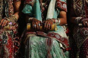 Muslim brides wait for start of mass marriage ceremony in Mumbai