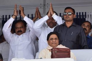 Lucknow: BSP supremo Mayawati with party workers at a function to commemorate the tenth death anniversary of the party founder Kanshiram in Lucknow on Sunday. PTI Photo by Nand Kumar  (PTI10_9_2016_000123A)