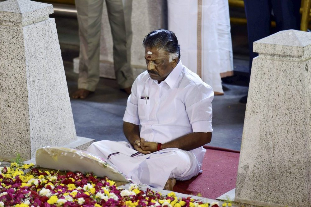 Chennai: Tamil Nadu Chief Minister O Panneerselvam sitting in a meditation in front of late J Jayalalithaa's burial site at the Marina Beach in Chennai on Tuesday. On Sunday, he tendered his resignation from the post paving the way for AIADMK General Secretary V K Sasikala to become Chief Minister. PTI Photo by R Senthil Kumar(PTI2_7_2017_000260B)