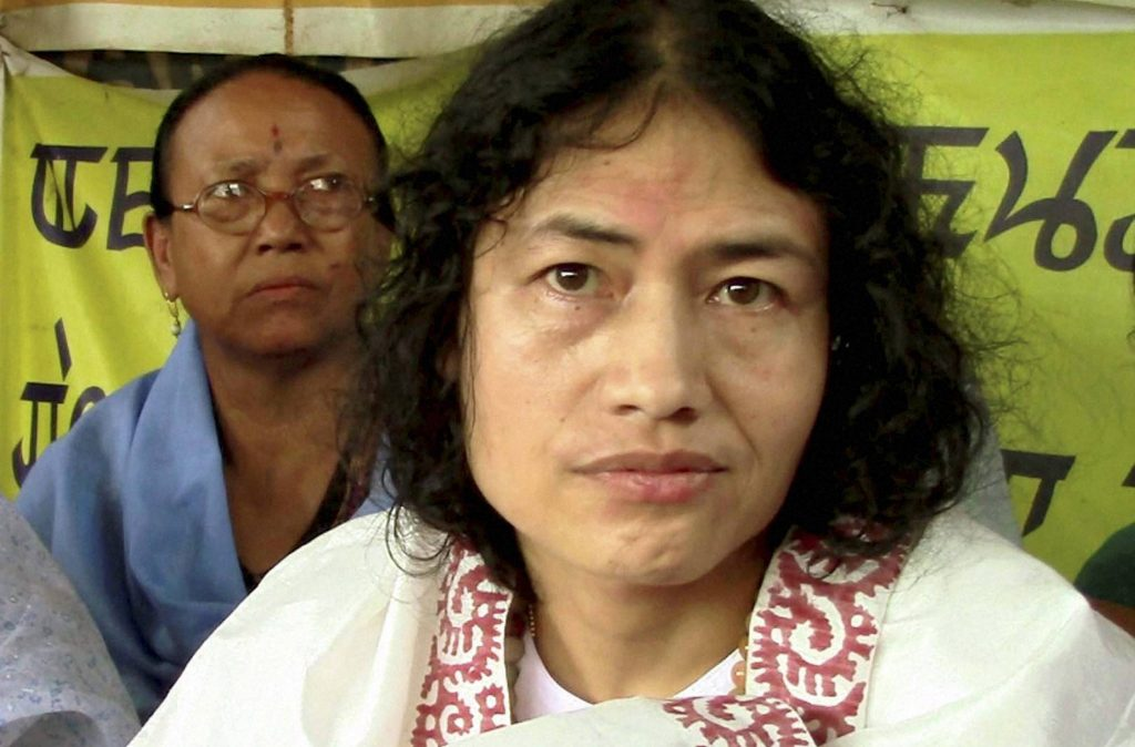 Imphal: Activist Irom Sharmila Chanu, who is on an indefinite fast in Manipur for nearly 14 years demanding repeal of AFSPA, being re-arrested in Imphal on Friday, two days after she was released following a court order. PTI Photo (PTI8_22_2014_000188A)