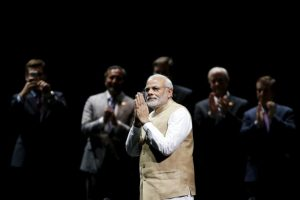 Indian Prime Minister Narendra Modi gestures on stage during a community reception at SAP Center in San Jose, California September 27, 2015. REUTERS/Stephen Lam