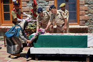 Srinagar: Jammu and Kashmir Chief Minister Mehbooba Mufti laying a wreath at the coffin of slain DSP Mohammed Ayub Pandit during a ceremony at District Police Lines in Srinagar on Friday. Pandit was reportedly lynched to death by the mob outside historic Jamia Masjid in Nowhatta area of Srinagar. PTI Photo by S Irfan