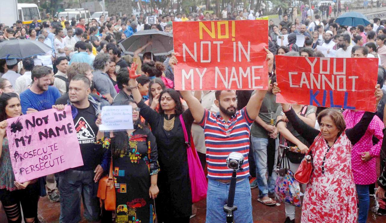 """Mumbai : People participating the silent protest """"Not in My Name"""" against the targeted lynching in Mumbai on Wednesday. PTI Photo (PTI6_28_2017_000223A)"""