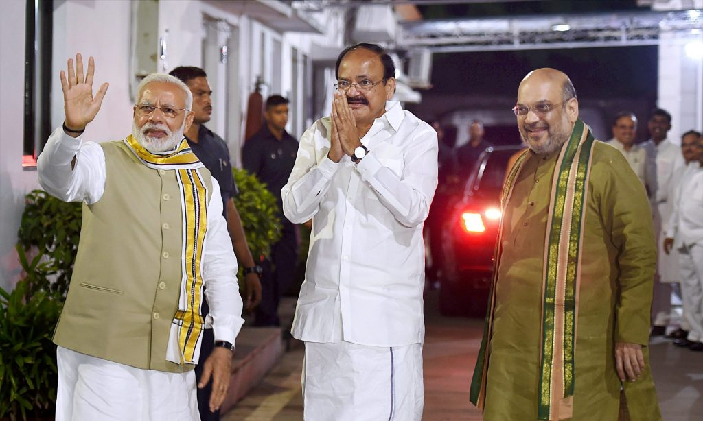 New Delhi: Union Minister M. Venkaiah Naidu with Prime Minister Narendra Modi and BJP President Amit Shah after he was announced as the BJP's Vice-Presidential candidate in New Delhi on Monday. PTI Photo by Atul Yadav (PTI7_17_2017_000335B)