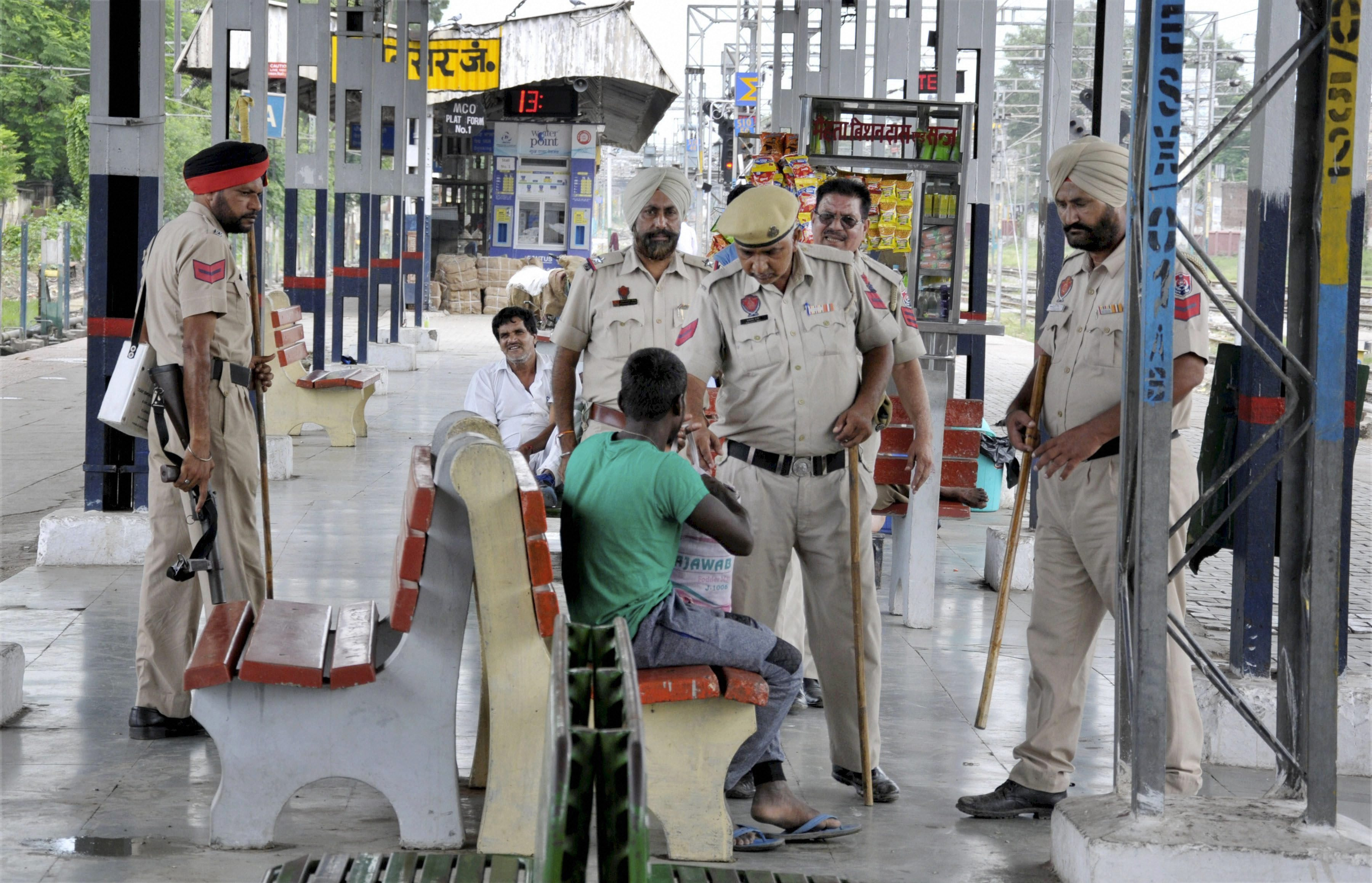 Amritsar: Police personnel take stock of the security situation at Amritsar railway station on Friday in view of apprehensions of unrest due to the verdict in a case against Dera Sacha Sauda chief Gurmeet Ram Rahim Singh. PTI Photo(PTI8_25_2017_000076B)