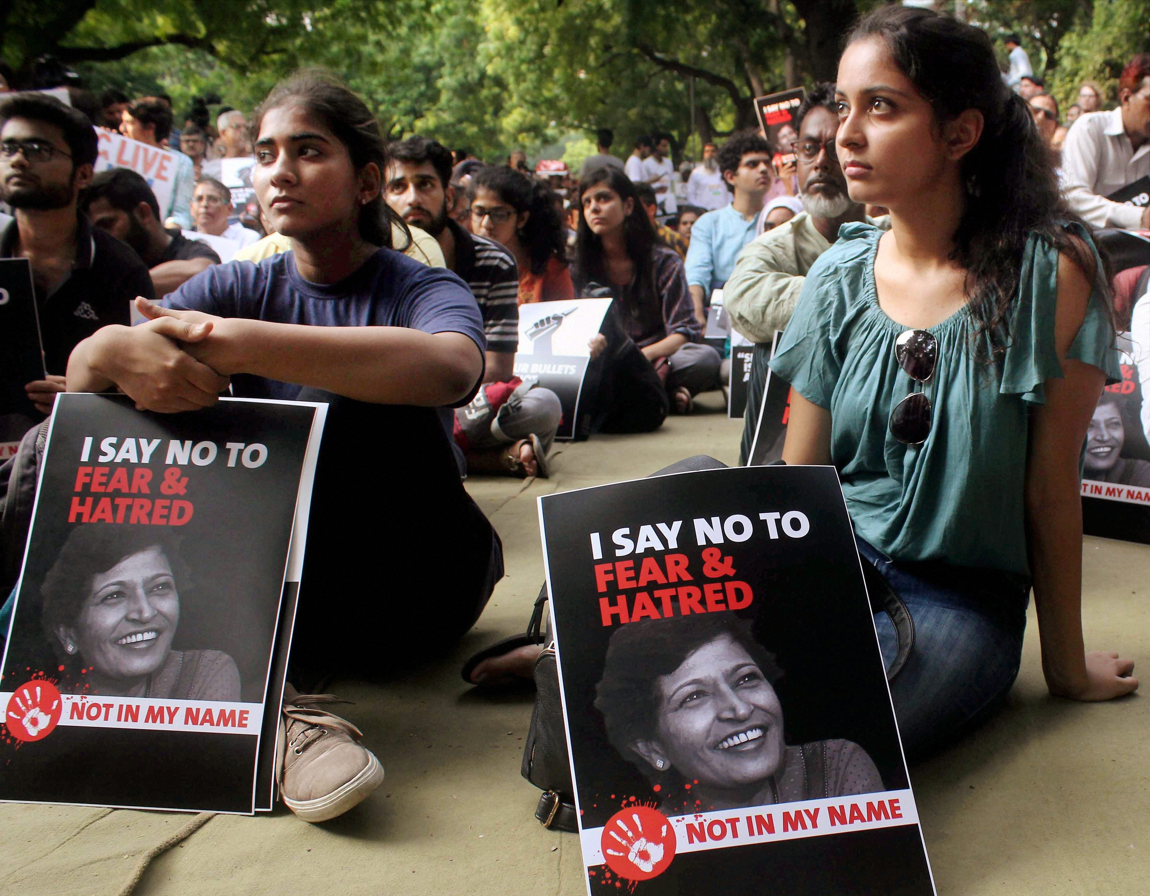 New Delhi: Demonstrators hold placards with the picture of journalist Gauri Lankesh during a 'Not In My Name' protest at Jantar Mantar in New Delhi on Thursday. PTI Photo(PTI9_7_2017_000157B)