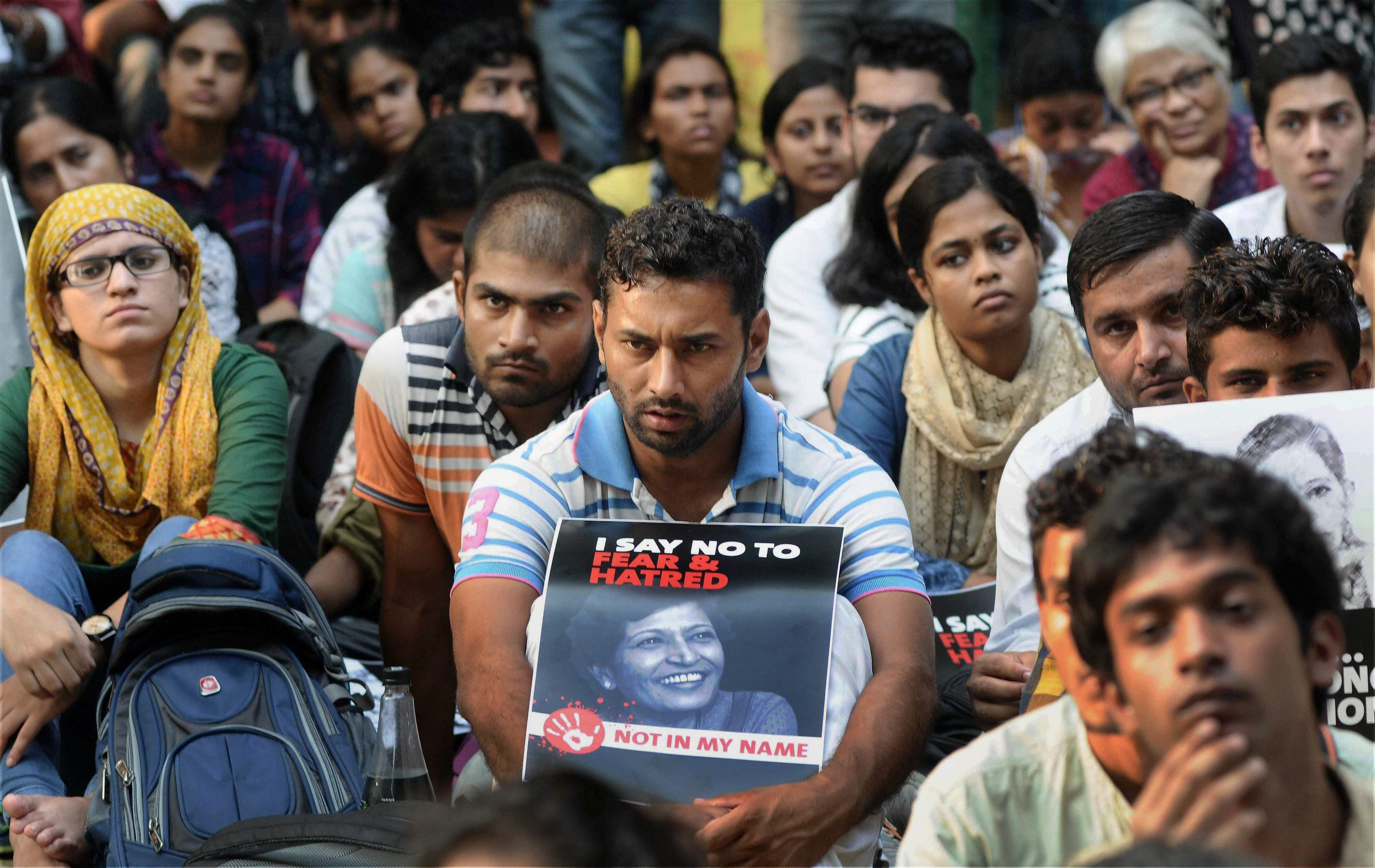 New Delhi: Demonstrators hold placards with the picture of journalist Gauri Lankesh during a 'Not In My Name' protest, at Jantar Mantar in New Delhi on Thursday. PTI Photo(PTI9_7_2017_000160B)