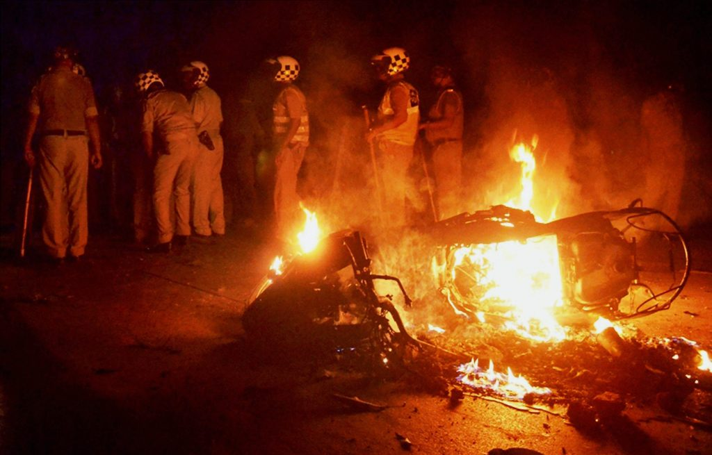 Varanasi: A bike in flames during clashes between the students and police at Banaras Hindu University in Varanasi, late Saturday night. Female students at the prestigious University were protesting against the administration's alleged victim-shaming after one of them reported an incident of molestation on Thursday. PTI Photo (PTI9_24_2017_000079B)