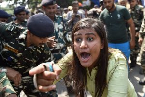 New Delhi: Security men detain ABVP members who were protesting in support of Banaras Hindu University (BHU) girls agitation, outside HRD Ministry in New Delhi on Monday. PTI Photo by Manvender Vashist (PTI9 25 2017 000086A)
