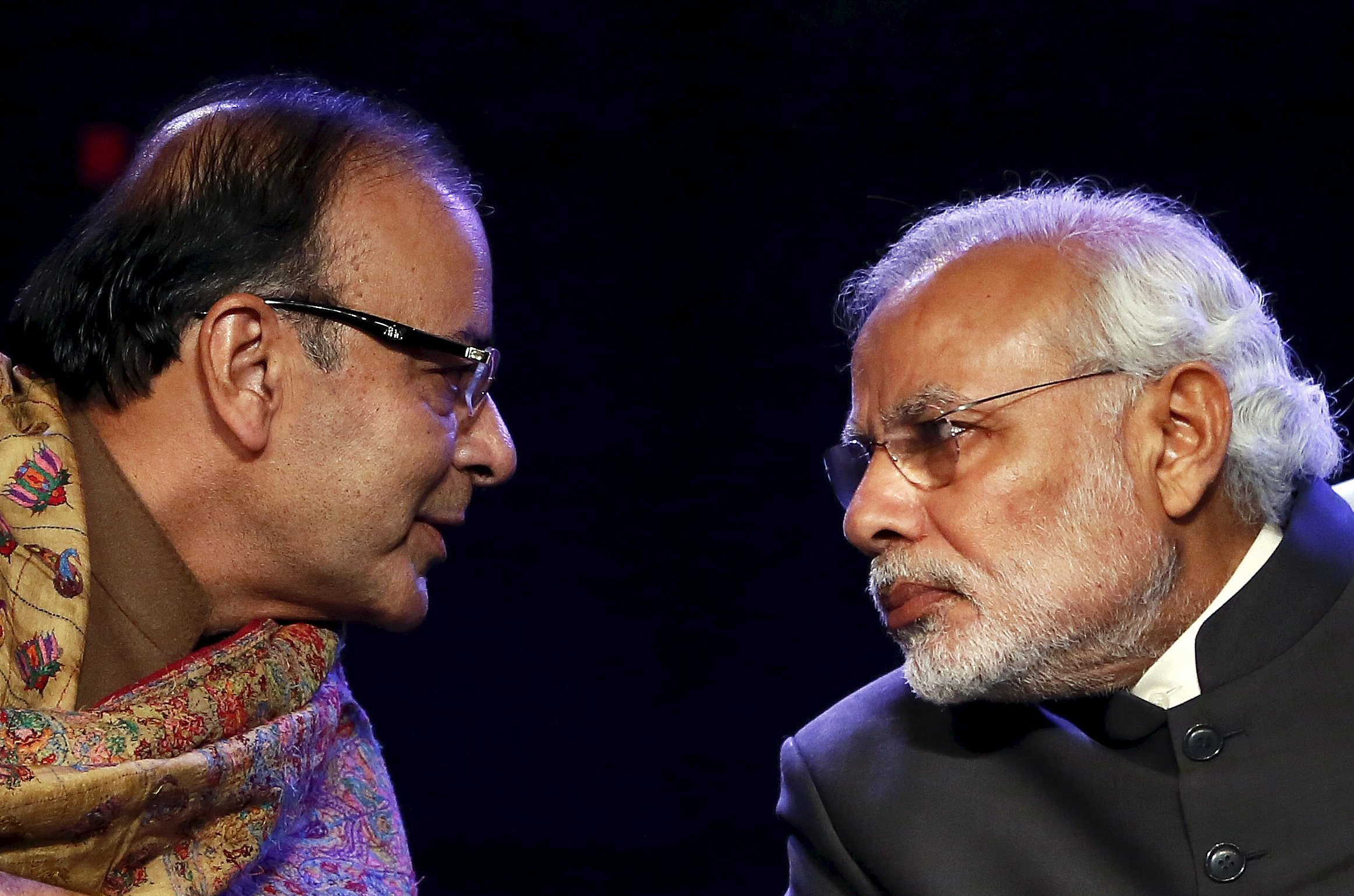 Indian Prime Minister Narendra Modi (R) listens to Finance Minister Arun Jaitley during the Global Business Summit in New Delhi, India, in this January 16, 2015 file photo. After a drubbing in a state poll in November, Modi wants to overhaul his cabinet to weed out underperformers and improve his government's image. Problem is, several sources said, he can't find the right replacements.   REUTERS/Anindito Mukherjee/Files