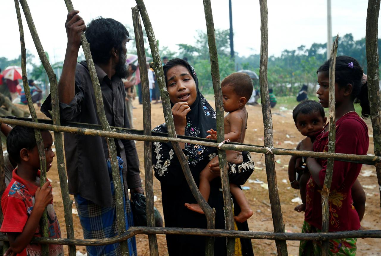 A new Rohingya refugee woman cries as they arrive near the Kutupalang makeshift Refugee Camp, in Cox's Bazar, Bangladesh, August 30, 2017. REUTERS/Mohammad Ponir Hossain