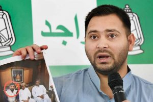 Patna: Leader of Opposition in bihar Assembly, Tejaswi Yadav addressing a press conference at his residence in Patna on Tuesday. PTI Photo (PTI10_31_2017_000138B)