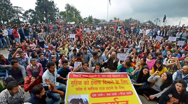 Shimla: People staging a demonstration to demand justice for a 16-year-old school girl, who was raped and murdered in Kotkhai, in Shimla on Saturday. PTI Photo (PTI7_15_2017_000065B)