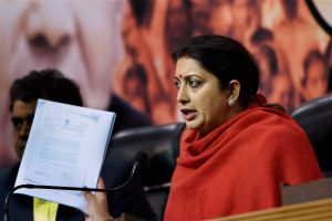 New Delhi : Union HRD minister Smriti Irani show documents while addressing a press conference regarding Aam Aadmi Party's charges of corruption against Finance Minister Arun Jaitley related to Delhi and Development Cricket Association, BJP headquarters in New Delhi on Thursday. PTI Photo by Subhav Shukla (PTI12_17_2015_000111B)