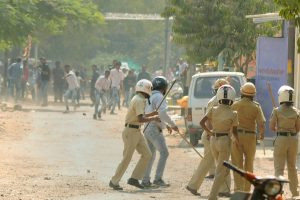 Aurangabad: RPI activists pelting stones at the police during their violent protest in Aurangabad on Tuesday, over the clashes that broke out at 200th anniversary celebrations of the Battle of Bhima in Koregaon, near Pune. PTI Photo    (PTI1_2_2018_000115B)