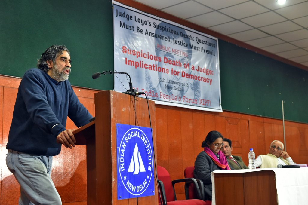 New Delhi: Hartosh Singh Bal, noted journalist and political editor, The Caravan, speaks during a public meeting on 'Judge Loya's Suspicious Death' in New Delhi on Monday. PTI Photo by Kamal Kishore (PTI1_15_2018_000198B)