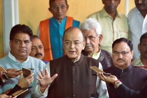 New Delhi: Finance Minister Arun Jaitley addressing the media along with other union ministers on 2G scam at Parliament House, in New Delhi on Thursday. PTI Photo by Subhav Shukla (PTI12_21_2017_000026B)