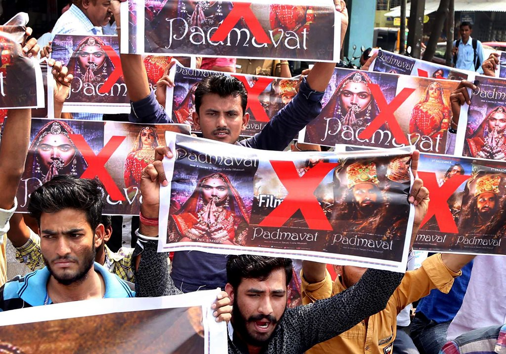 """Coimbatore: Activists of Rashtriya Rajput Karni Sena holding banners and raising slogans during a protest against the release of the film """"Padmaavat"""" in Coimbatore on Thursday. PTI Photo (PTI1_25_2018_000088B)"""