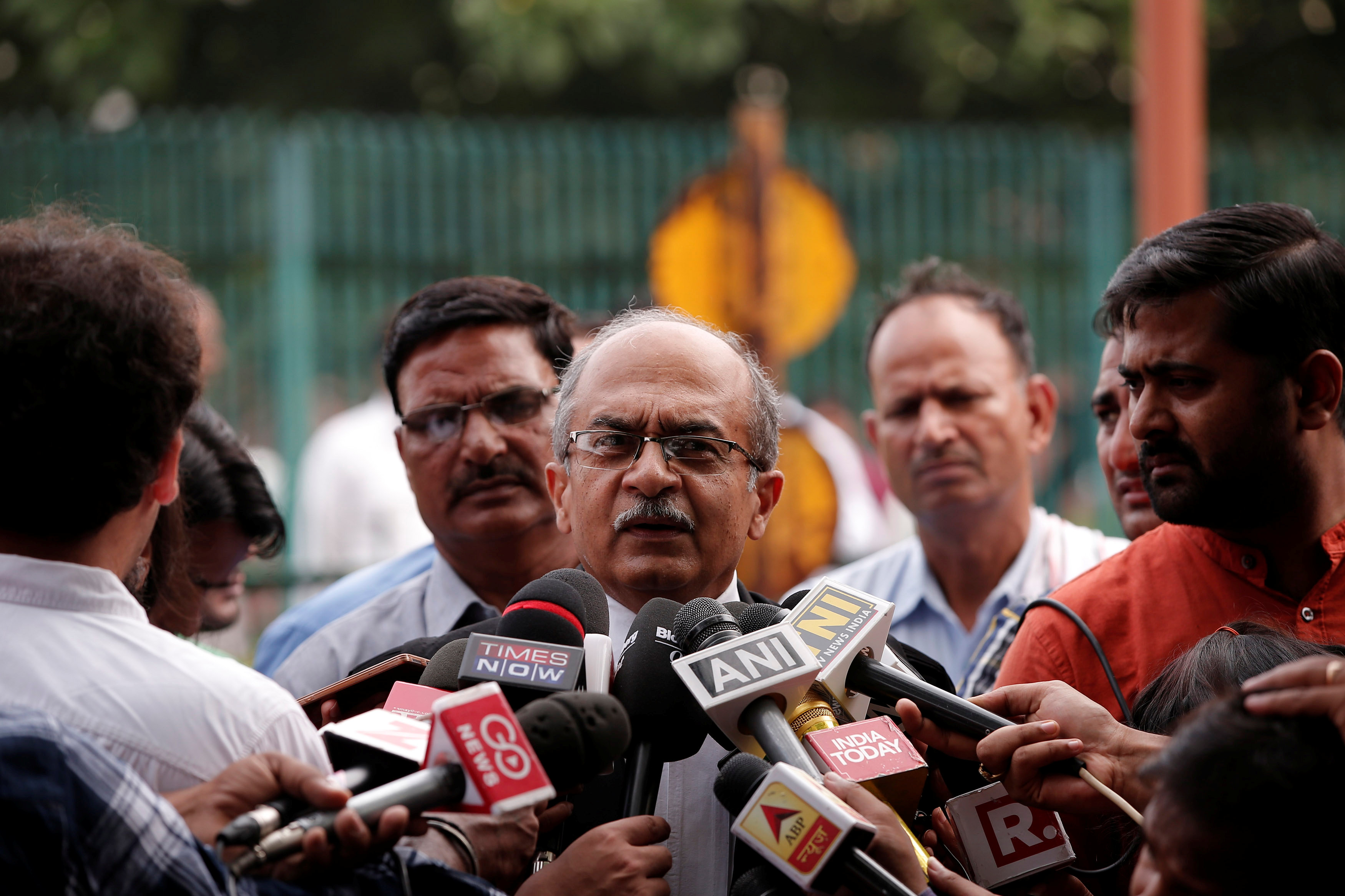 Prashant Bhushan, a senior lawyer, speaks with the media after a verdict on right to privacy outside the Supreme Court in New Delhi, India August 24, 2017. REUTERS/Adnan Abidi