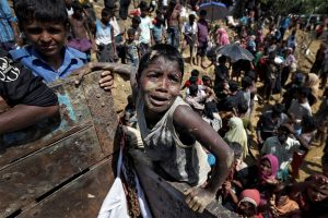 Rohingya refugees react as aid is distributed in Cox's Bazar, Bangladesh, on Thursday. Cathal McNaughton, Reuters (Sep 21 2017)