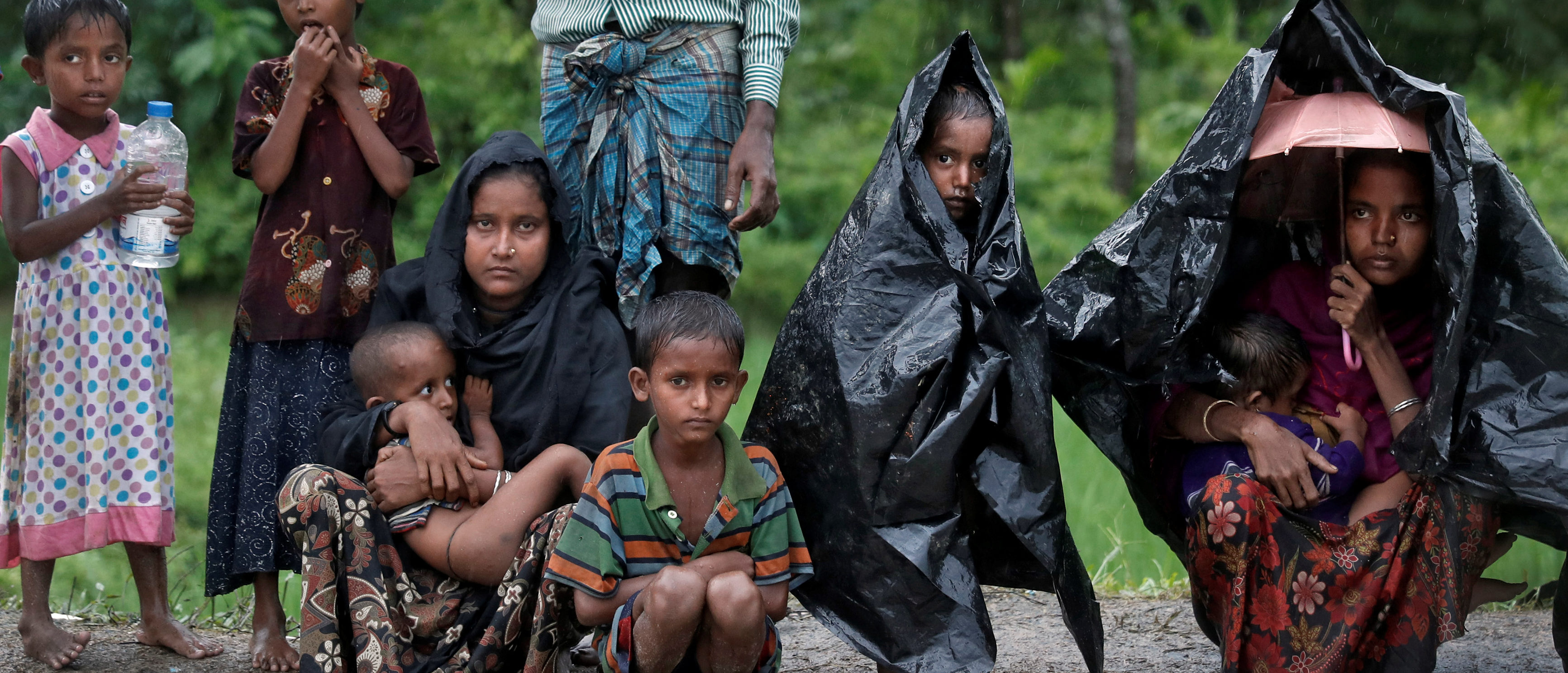 Rohingya refugees wait for aid in Cox's Bazar, Bangladesh, September 20, 2017. REUTERS/Cathal McNaughton - RC1B9FAA4560