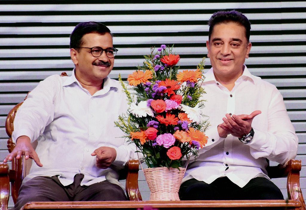 "Madurai: Tamil film icon Kamal Haasan with Delhi Chief Minister Arvind Kejriwal during the launch of political party ""Makkal Neethi Maiam"" in Madurai on Wednesday. PTI Photo(PTI2_21_2018_000227B)"