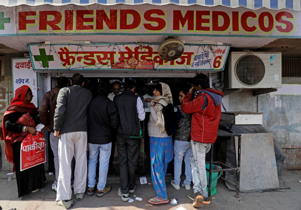 People crowd outside a chemist store in New Delhi, India February 2, 2018. REUTERS/Saumya Khandelwal