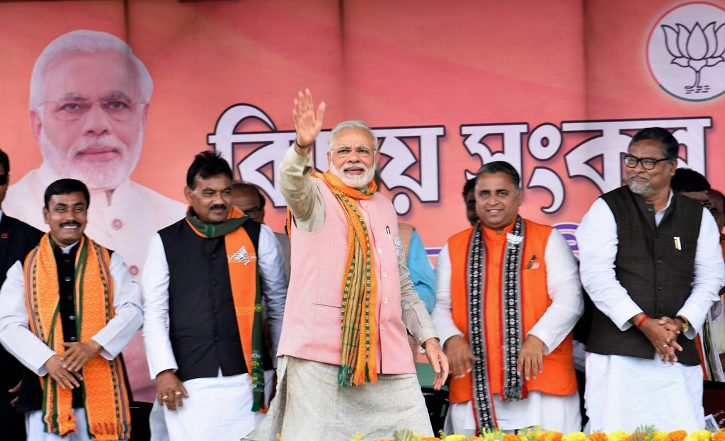 Sonamura: Prime Minister Narendra Modi waves at the public during an election campaign rally ahead of Tripura Assembly Election in Sonamura on Thursday. PTI Photo (PTI2_8_2018_000075B)