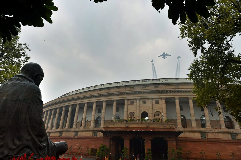 New Delhi: Indian Air Force C-17 Globemaster III (C) and SU-30, planes fly past over the Parliament house during Republic Day rehearsals in New Delhi on Tuesday. PTI Photo by Vijay Verma(PTI1_23_2018_000044B)