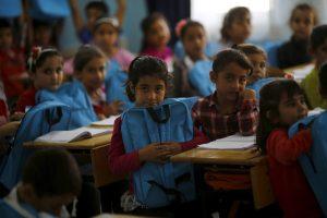 Syrian refugee children are seen during a lesson at Fatih Sultan Mehmet School in Karapurcek district of Ankara, Turkey, October 2, 2015. Image: REUTERS/Umit Bektas