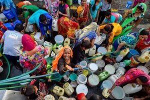New Delhi: Residents of Vivekanand camp gather around a Municipal Corporation tanker to fill water, at Chanakyapuri in New Delhi, on Wednesday. According to the UN, the theme for World Water Day 2018, observed on March 22, is 'Nature for Water' – exploring nature-based solutions to the water challenges we face in the 21st century. PTI Photo by Ravi Choudhary (PTI3_21_2018_000121B)