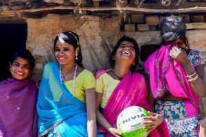 ::STANDALONE PHOTO PACKAGE:: Udaipur: Shanta (10), Meena (15), Champa (12) and Pushpa (16) in a light mood after a friendly match at village Mota Bhata in Udaipur. An NGO, Vikalp Sansthan, is training girls of this Bhil tribe in volleyball; in an attempt to try and pull them out of their homes and making them comfortable not just in the open fields of the village area but also with their own selves. The girls from this extremely remote area of Rajasthan have found a means of self expression through this simple game. International Women's Day observed on March 8th, has 'Press for Progress', which promotes gender parity as it theme this year. PTI Photo by Rohit Jain(PTI3_7_2018_000136B)