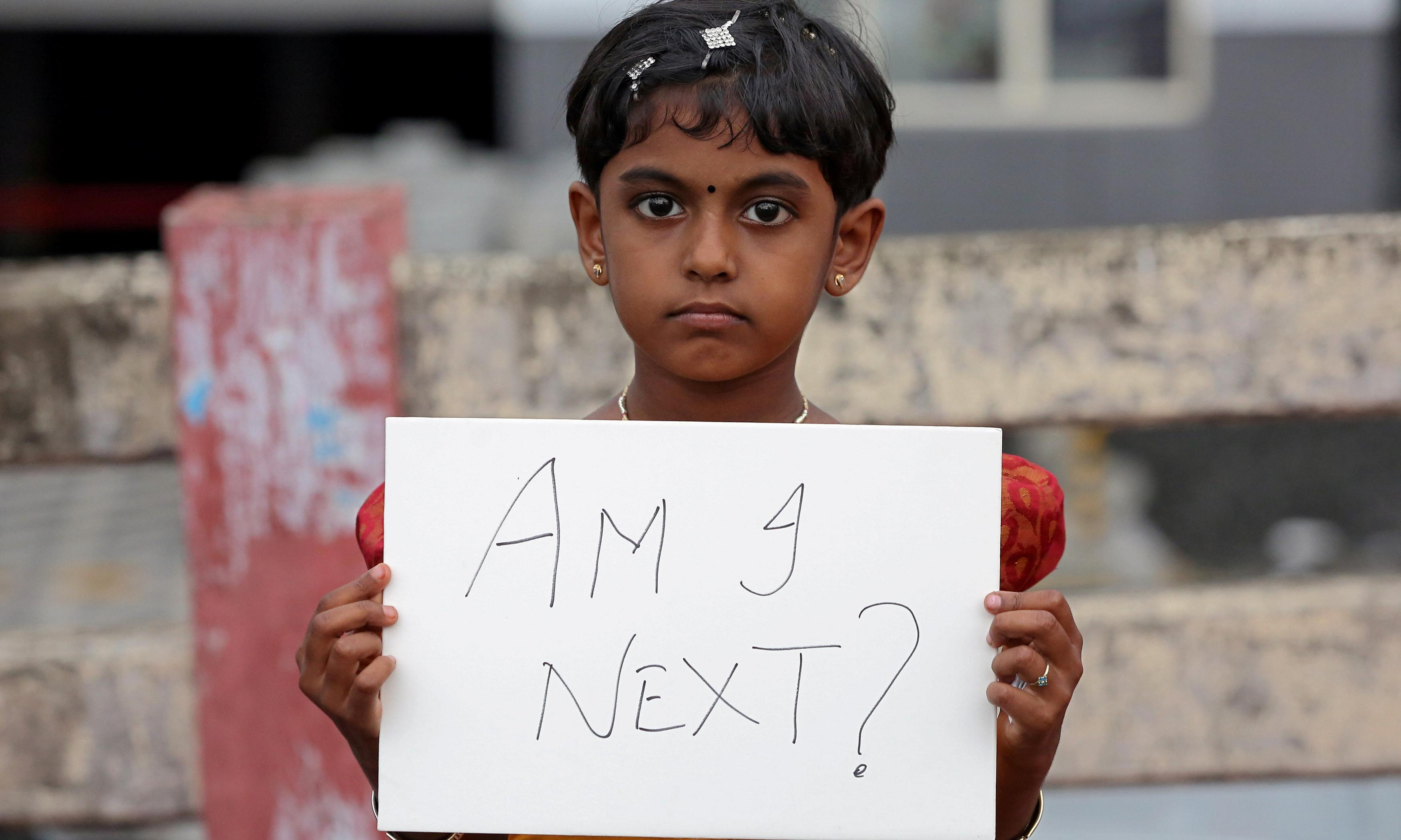 A girl in Kochi, in the south-western state of Kerala, protests against the rape in Kathua, near Jammu, northern India. Photograph: Sivaram V/Reuters