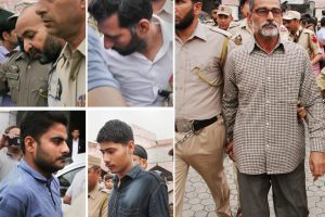 Jammu: **COMBO** Prime accused Sanji Ram (R) and other accused of Kathua rape and murder case, being produced in District Court in Kathua, about 85km from Jammu on Monday. PTI Photo (PTI4_16_2018_000037B)