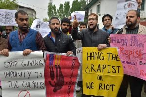 Srinagar: A group of people display placards and raise slogans during a protest demanding justice for eight year old Ashifa of Kathwa Jammu, who was allegedly gangraped and murdered, in Srinagar on Tuesday. PTI Photo by S. Irfan (PTI4_10_2018_000129B)