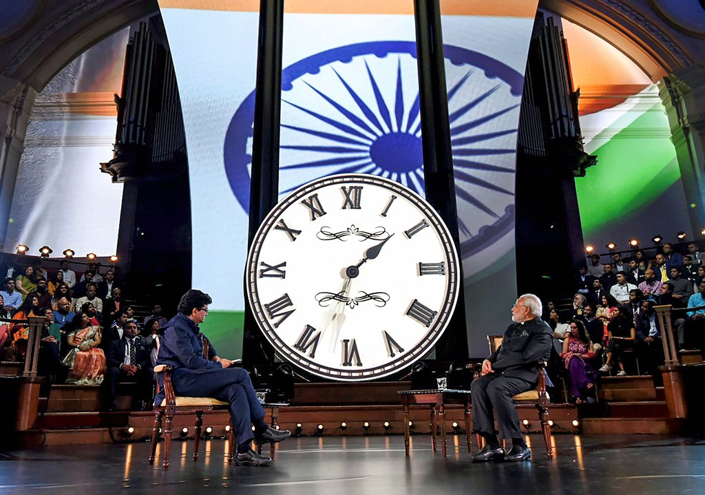 London: Prime Minister Narendra Modi interacts with the members of the Indian community, at 'Bharat Ki Baat, Sabke Saath' programme, at Westminster, London on Wednesday. PTI Photo / PIB(PTI4_19_2018_000067B)