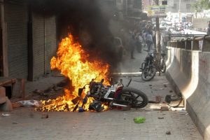 Ghaziabad: A bike set on fire by a group of protesters during 'Bharat Bandh' call given by Dalit organisations against the alleged dilution of Scheduled Castes / Scheduled Tribes Act, in Ghaziabad on Monday. PTI Photo (PTI4_2_2018_000026B)