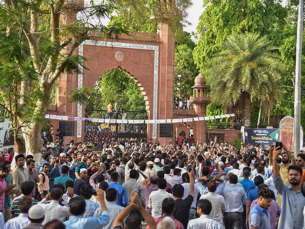Aligarh: Aligarh Muslim University's Women's College joined in a protest with university students during a protest at the gate of their campus in Aligarh on Thursday. PTI Photo (PTI5_3_2018_000172B)