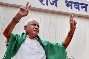 Bengaluru: Newly sworn-in Karnataka Chief Minister B. S. Yeddyurappa flashes the victory sign after his swearing-in ceremony, at Raj Bhavan in Bengaluru on Thursday. (PTI Photo)(PTI5_17_2018_000113B)