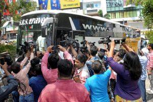 Hyderabad: Media surrounds the bus as Karnataka Congress and JD(S) MLAs arrive at Taj Krishna Hotel, in Hyderabad, on Friday. (PTI Photo) (PTI5_18_2018_000183B)