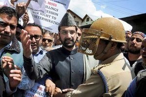 Srinagar: Mirwaiz Umar Farooq, Chairman, Hurriyat Conference defies his house detention and leads a rally to protest against the visit of Prime Minister Narendra Modi, in Srinagar, on Saturday. (PTI Photo) (PTI5_19_2018_000060B)