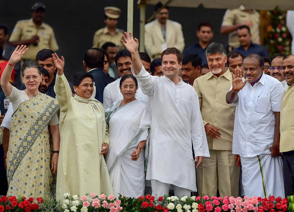 RPTwith caption correction::: Bengaluru: Newly sworn-in Karnataka Chief Minister H D Kumaraswamy, Andhra Pradesh CM N Chandrababu Naidu, AICC President Rahul Gandhi, West Bengal CM Mamata Banerjee, Bahujan Samaj Party (BSP) leader Mayawati and Congress leader Sonia Gandhi wave during the swearing-in ceremony of JD(S)-Congress coalition government in Bengaluru on Wednesday. (PTI Photo/Shailendra Bhojak) (PTI5_23_2018_000145B)