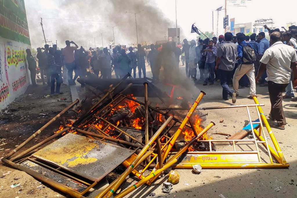 Tuticorin: Smoke billows from burning barricades as agitators march through streets demanding the closure of Vedanta's Sterlite Copper unit, as the protest entered the 100th day, in Tuticorin, on Tuesday. The agitation turned violent with police opening fire in which at least one man was killed. (PTI Photo) (PTI5_22_2018_000185B)