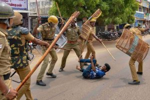Tuticorin: Police personnel baton charge at a protestor demanding the closure of Vedanta's Sterlite Copper unit, in Tuticorin, on Wednesday. In fresh violence today, one person was killed during the clash, after police's open fire killing at least ten people yesterday, and injuring many others. (PTI Photo) (PTI5_23_2018_000193B)