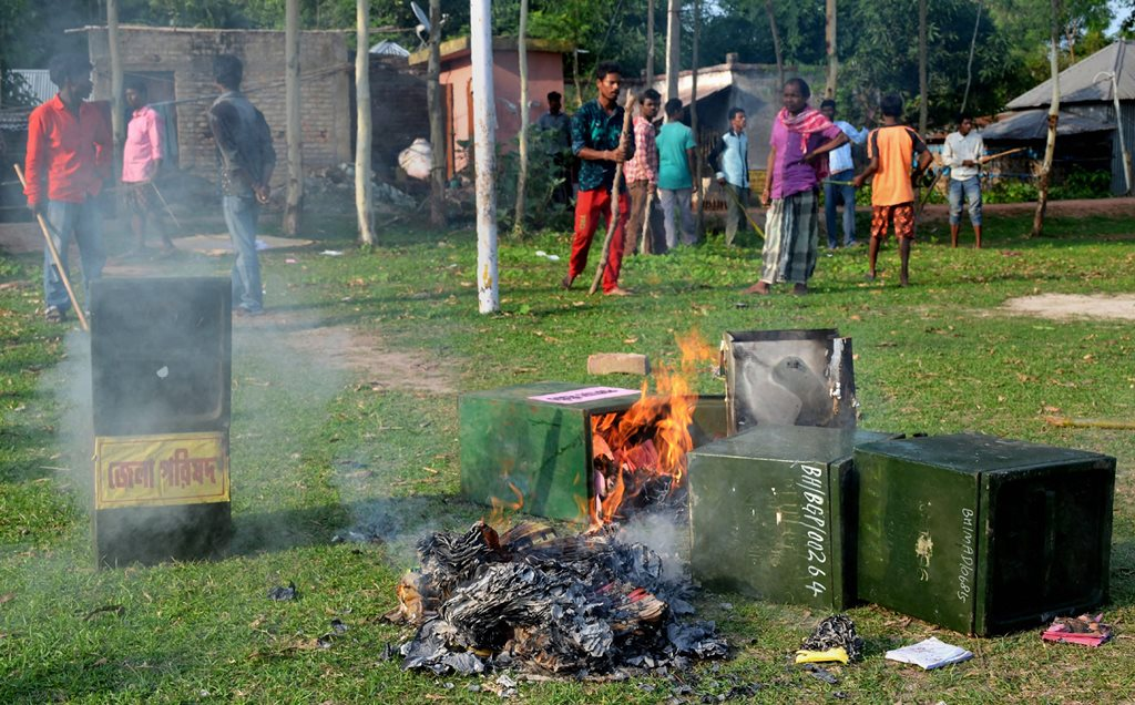 Malda: Unknown people burn ballot boxes after snatching them from a polling booth during  Panchayat polls at Deotala in Malda district of West Bengal,  on Monday. PTI Photo(PTI5_14_2018_000178B)
